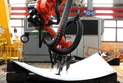 World's largest shipbuilder unveils robots to construct vessels