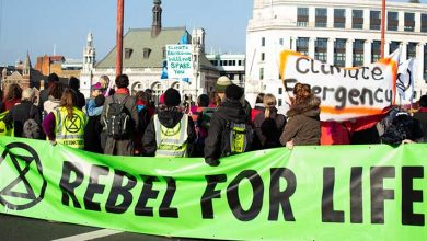 Photo of Climate protestors stage demonstration against commodity traders in Geneva