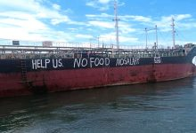 Photo of Abandoned crew scrawl their desperate plight along ship's hull