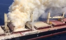 Salvors try to cool burning ship off the Canary Islands