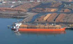 Crew evacuated as timber slides off listing Russian ship