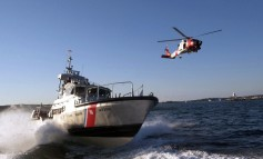 USCG helicopter crew airlifts ailing crewman from Maersk ship offshore Alaska